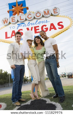 Friends in front of a 'Welcome to Las Vegas' sign
