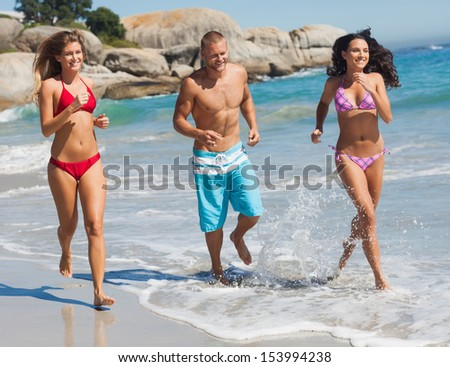 Friends jogging on the beach together