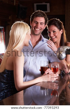Friends laughing at bar - stock photo