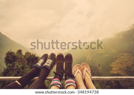 Friends legs outdoor on mountain background. Travel together  - stock photo