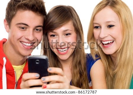 Friends looking at mobile phone - stock photo