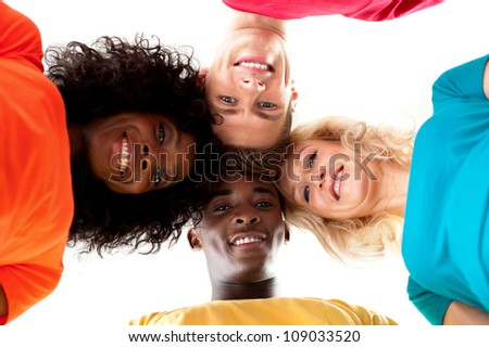 Friends making circle and looking down at camera. Trendy style and pose - stock photo