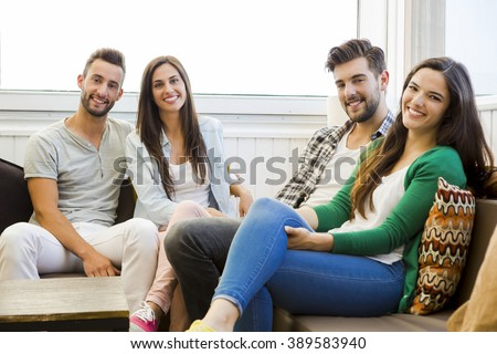 Friends meeting at the local coffee shop and having fun - stock photo
