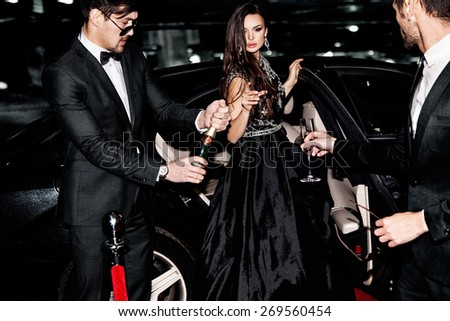 Friends near the car. Hollywood star. Celebrating.  - stock photo
