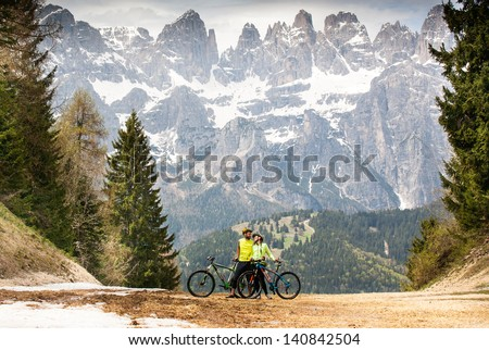 friends on a bike ride in the woods in the mountains of the Dolomites. Italy. - stock photo