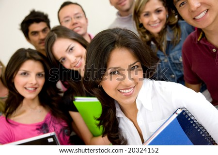 friends or university students smiling in a classroom - stock photo