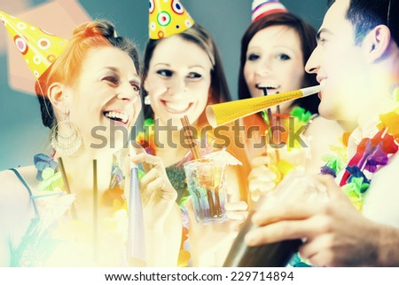 Friends partying in cocktail bar with hats and music - stock photo