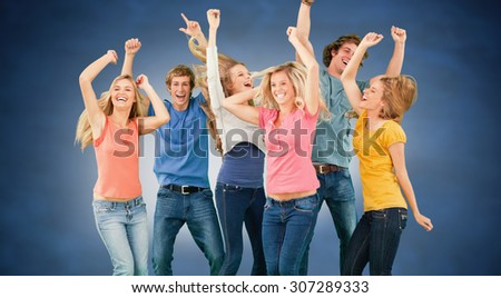 Friends partying together while laughing and smiling against blue chalkboard