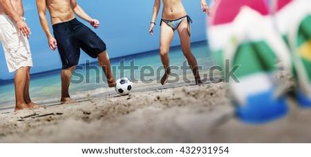 Friends Playing Beach Football Summer Concept - stock photo