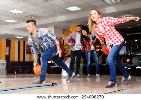 Friends playing in bowling club - stock photo