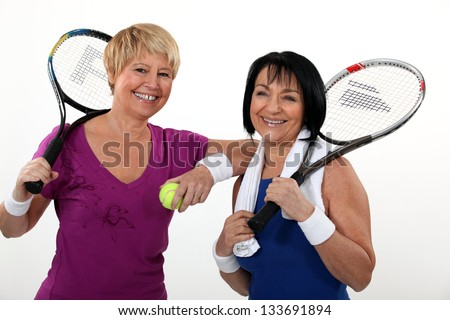 Friends playing tennis - stock photo