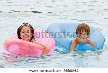 Friends Playing Together in the Pool - stock photo