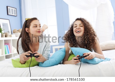Friends playing video game   - stock photo