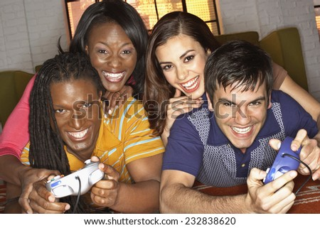 Friends Playing Video Games - stock photo