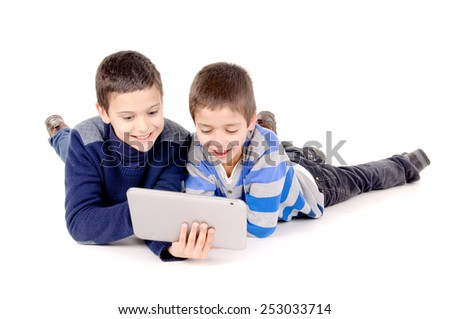 friends playing with tablet isolated in white background - stock photo