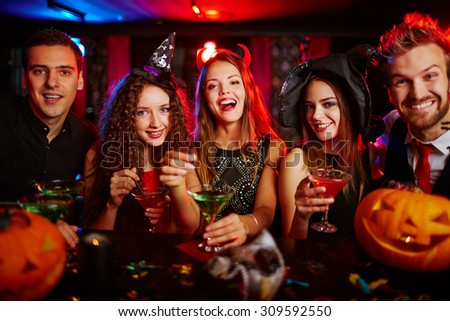 Friends resting in nightclub at Halloween - stock photo