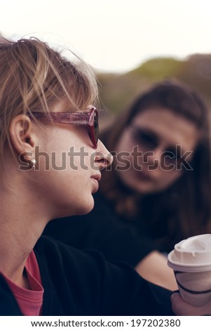 Friends serious chatting outdoors. - stock photo