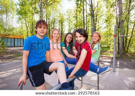 Friends sitting on brachiating at the playground