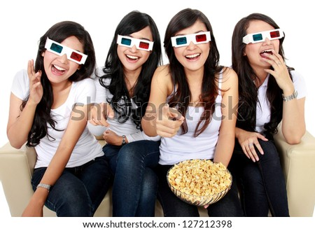 friends sitting on couch laughing at comedy movie in 3d - stock photo