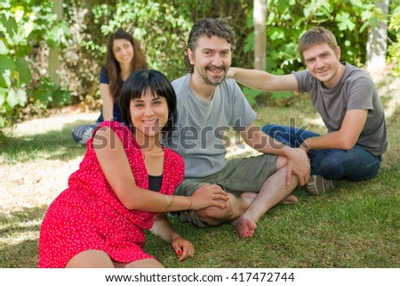 friends spending time together at the park - stock photo