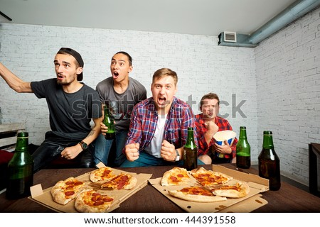 Friends sprot watching on TV, have fun, eat pizza. Friends to eat pizza, drink alcohol, shout and laugh. The concept of men's rest. - stock photo