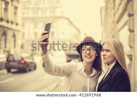 Friends taking a picture of themselves - stock photo