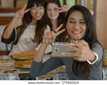 Friends taking picture in restaurant