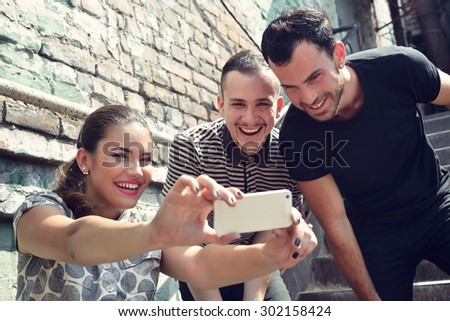 Friends taking self photo with smart phone. Selfie, friendship, young adult, leisure concept. - stock photo