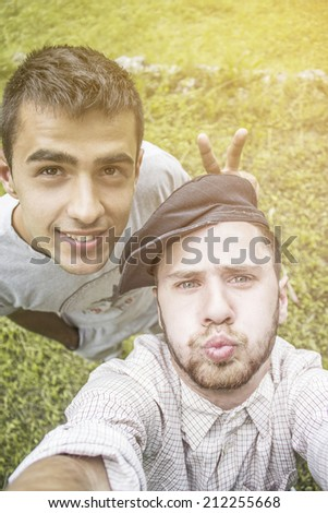 Friends taking self portrait in the europe. Smiling young man.Travel selfie. - stock photo
