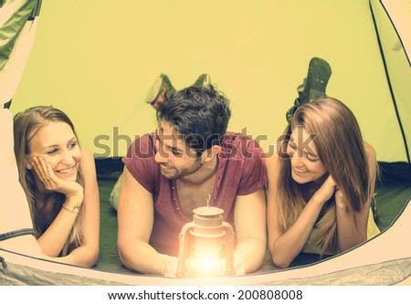 Friends talking in a camping tent - stock photo