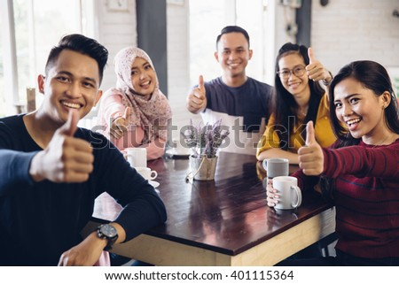 Friends Thumbs up Togetherness Fun Concept - stock photo
