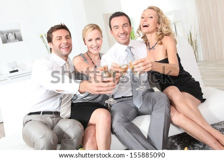 Friends toasting with champagne - stock photo