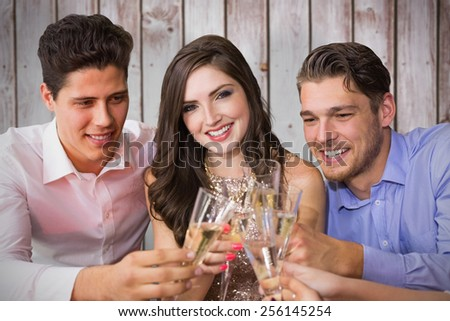 Friends toasting with champagne against wooden planks