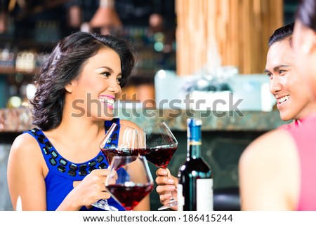 Friends toasting with wine in restaurant