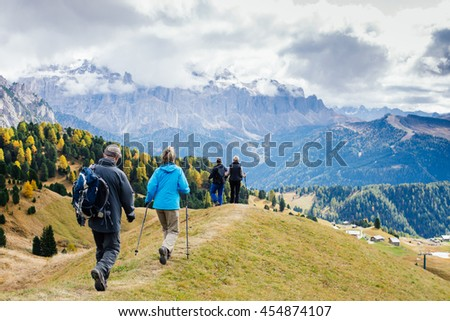 Friends tourists trekking in the mountains of the Dolomite, Alps