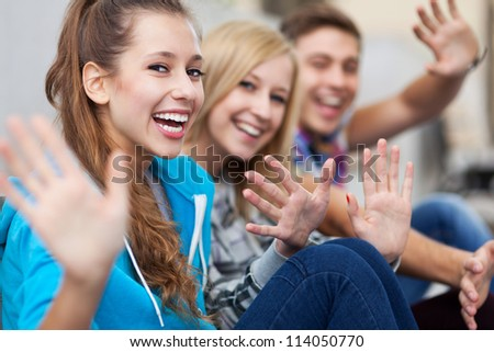 Friends waving - stock photo