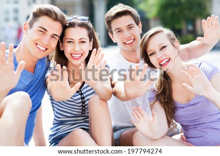 Friends waving hands - stock photo