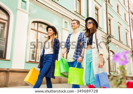 Friends with shopping bags during travel in Europe