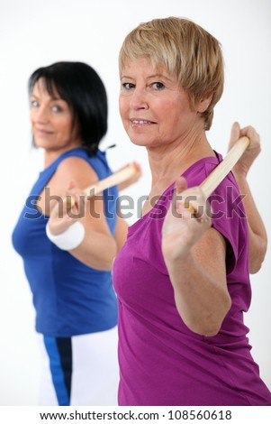 Friends working out at the gym together - stock photo