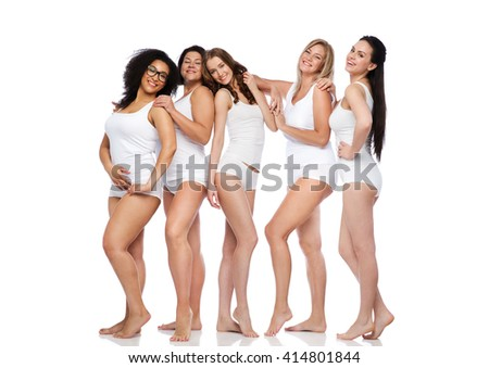 friendship, beauty, body positive and people concept - group of happy women different in white underwear - stock photo