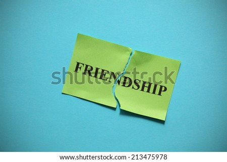 "Friendship breakdown (destroy a friendship). Torn of paper with the word ""Family"". Concept Image. Closeup. - stock photo"