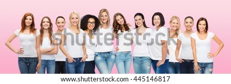 friendship, diversity, body positive and people concept - group of happy women of different age size and ethnicity in white t-shirts hugging over pink background