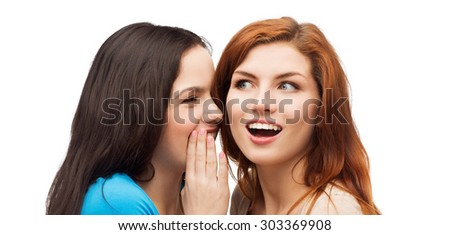friendship, happiness and people concept - two smiling girls whispering gossip - stock photo