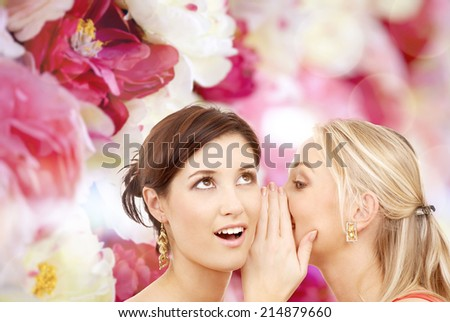 friendship, happiness and people concept - two smiling women whispering gossip - stock photo