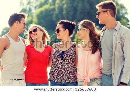 friendship, leisure, summer and people concept - group of smiling friends in city