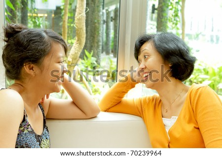 Friendship of asian ethnic mother and teen daughter - stock photo