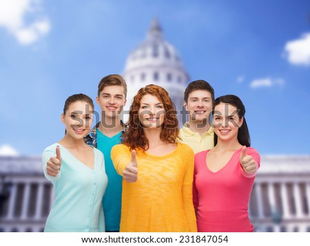 friendship, tourism, travel and people concept - group of smiling teenagers standing over white house background - stock photo