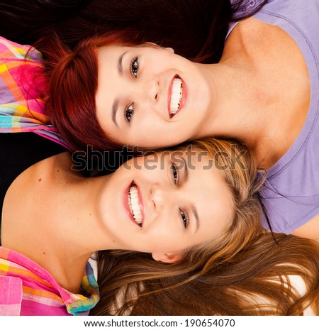 friendship,two best friends lying, smiling - stock photo