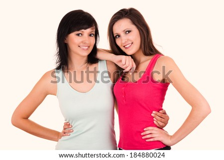 Friendship - Two best girlfriends hugging each other, white background - stock photo