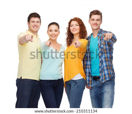 friendship, youth and people concept - group of smiling teenagers pointing fingers on you - stock photo